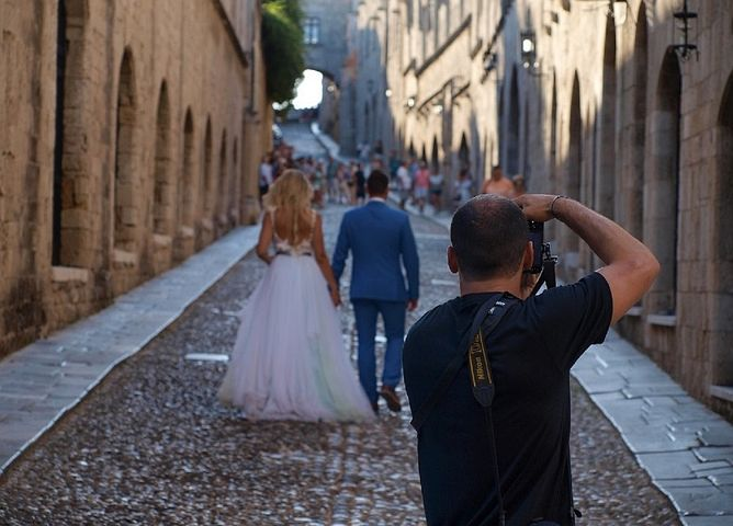 wedding couple being photographed