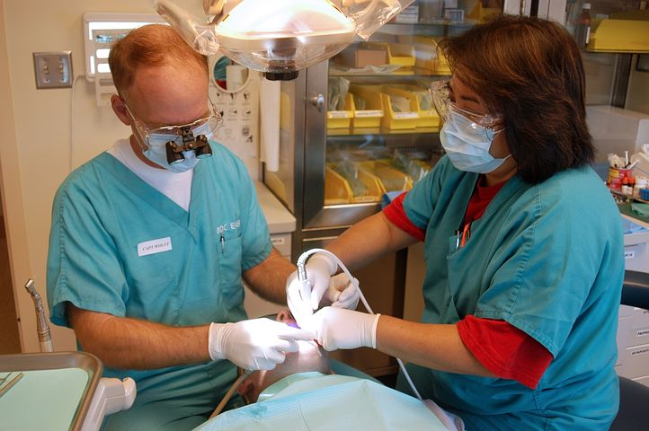 Two emergency dentists in Lilydale treating a patient