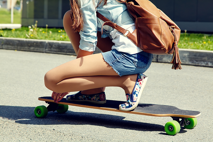 Woman trying out a skateboard