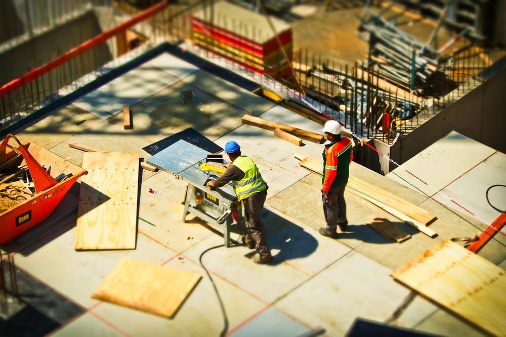 Construction workers installing cork filler board